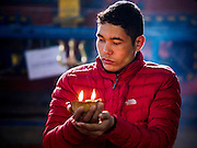 07 MARCH 2017 - KATHMANDU, NEPAL: A man prays at the Kamaladi Ganesh Temple, the most important Hindu temple dedicated to Ganesh, known as the overcomer of obstacles, in Kathmandu. In Hindu theology, Tuesdays are the best day to pray to Ganesh and the temple is very busy on Tuesdays. People frequently visit temples dedicated to Ganesh when they buy a new home or start a new job.     PHOTO BY JACK KURTZ