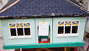 "Model toy house with humorous label saying 'No chain"" a term used within property transactions in Britain"