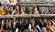 Sisters Sydney Korstad, 20 (left) and Lyndsey Korstad, 17, both of Shiloh, look through racks of clothing at the Gordman's store in Fairview Heights. Shoppers looking for bargains and discounted items endured a light but steady rain on Thanksgiving Day as they waited for stores to open in Fairview Heights, IL on November 28, 2019.<br />  Photo by Tim Vizer