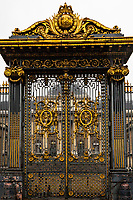 Ornate Paris Gate at Conciergerie - Thousands of doors and gates adorn buildings in Paris.  Some of the best are on government offices, cathedrals and churches, as well as a few chateau.  However, any self-respecting contractor with a decent budget probably spent a lot of consideration in installing suitable doors, windows, grill work and even doorknobs. Some of these gates, doors and windows are very simple, while others are extravagant works of art. The styles of these doors tell about the history of France. As you walk across the 20 arrondissements of Paris, you will discover Gothic, Renaissance, Haussmann and Art Nouveau door styles. It is up to you to take the time to look for little details of these Paris' most beautiful doors with statues, bas-reliefs, mascarons, gold-leaf, grills, handles and door knobs.