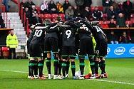 Yeovil Town players huddle before kick off during the EFL Sky Bet League 2 match between Swindon Town and Yeovil Town at the County Ground, Swindon, England on 10 April 2018. Picture by Graham Hunt.