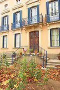 Chateau Mansenoble. In Moux. Les Corbieres. Languedoc. A door. In the garden. The main building. France. Europe.