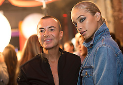 Designer Julien Macdonald with a model on the backstage during the London Fashion Week SS18 show held at No 1 Invicta Plaza, London