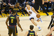 Golden State Warriors guard Klay Thompson (11) drives to the basket against the Atlanta Hawks at Oracle Arena in Oakland, Calif., on November 28, 2016. (Stan Olszewski/Special to S.F. Examiner)