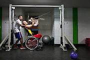 """2016/03/23 – Medellín, Colombia: Oscar Rios, 42, does exercises with the help of his fitness coach on the Envigado Gymnasium, Medellin, 23rd March, 2016.<br /> -<br /> After his military service Oscar started to work as a bodyguard for a public prosecutor, a time of great violence in Medellin, during the 1990's when Pablo Escobar ran the city. <br /> On an assassination attempt of the public prosecutor, Oscar was shot seven times by Escobar's assassins. As a result he lost the mobility of his legs and feet, becoming paraplegic. <br /> The adaptation to a new life was hard, but he decided that he had to separate the injury under his waist from his head, and to keep doing what he wanted. Oscar had always liked basketball, so he decided to dedicate himself to it. In 1998 he became part of Team Colombia on wheelchair basketball. During his successful career he was several time South American Champion, was with Colombia on the top ten teams at the 2014 World Championship in Korea and went to the 2012 Paralympic Games in London. Unfortunately, this year Colombia missed the qualification for the Rio 2016 Paralympic, which was Oscar last opportunity to be back at an Olympics. <br /> He plans to retire soon and became a full-time basketball coach. Oscar believes that there is much talent in Colombia that needs to be fostered. When asked about the accident and his life on the wheelchair, Oscar says, """"Before I was an arrogant person and didn't have any love to give to my family. The accident was a blessing that made me a better, happier man and to appreciate more my life and family. If I was going to be born tomorrow, I wanted to be born on a wheelchair"""". (Eduardo Leal)"""