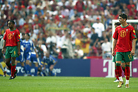 Fotball<br /> EURO 2004<br /> Portugal<br /> 12.06.2004<br /> NORWAY ONLY<br /> <br /> Hellas v Portugal<br /> <br /> Foto: Scott Heavey/Digitalsport<br /> <br /> A dejected Christiano Ronaldo (R) and Jorge Andrade walk away as Greece celebrate