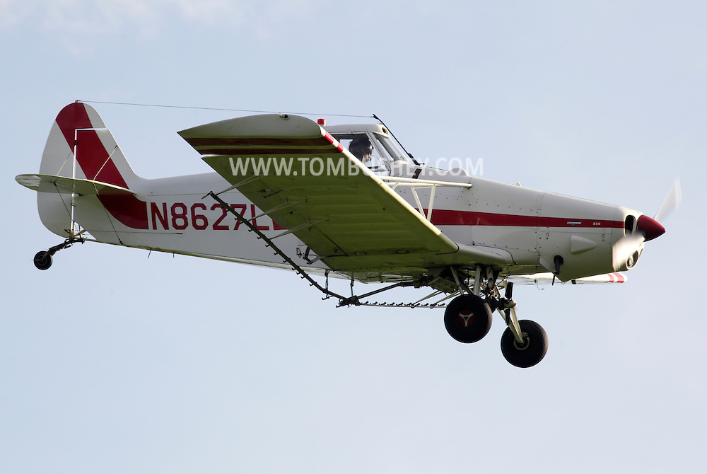 Goshen, New York - A Piper crop duster gets ready to spray herbicide over a black dirt onion field on May 21, 2011.