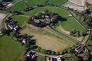 Nederland, Friesland, Gemeente Ferweradeel, 08-09-2009; Hogebeintum (Fries: Hegebeintum),  terpdorp. De terp is de hoogste van Friesland, maar alleen het deel met het kerkje heeft de oorspronkelijke hoogte, de rest van de terp is afgegraven, de vruchtbare grond diende als mest..Hogebeintum (Fries: Hegebeintum), mound village. The terp (mound) is the highest of Friesland, but only the part with the church has the original height, the rest of the mound has been excavated, the fertile ground served as fertilizer.luchtfoto (toeslag); aerial photo (additional fee required); .foto Siebe Swart / photo Siebe Swart