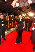 Neve Campbell, arrive at the 2006 BAFTA Awards at the Leicester Square Odeon Cinema in London. 19 February 2006.  -DO NOT ARCHIVE-© Copyright Photograph by Dafydd Jones 66 Stockwell Park Rd. London SW9 0DA Tel 020 7733 0108 www.dafjones.com