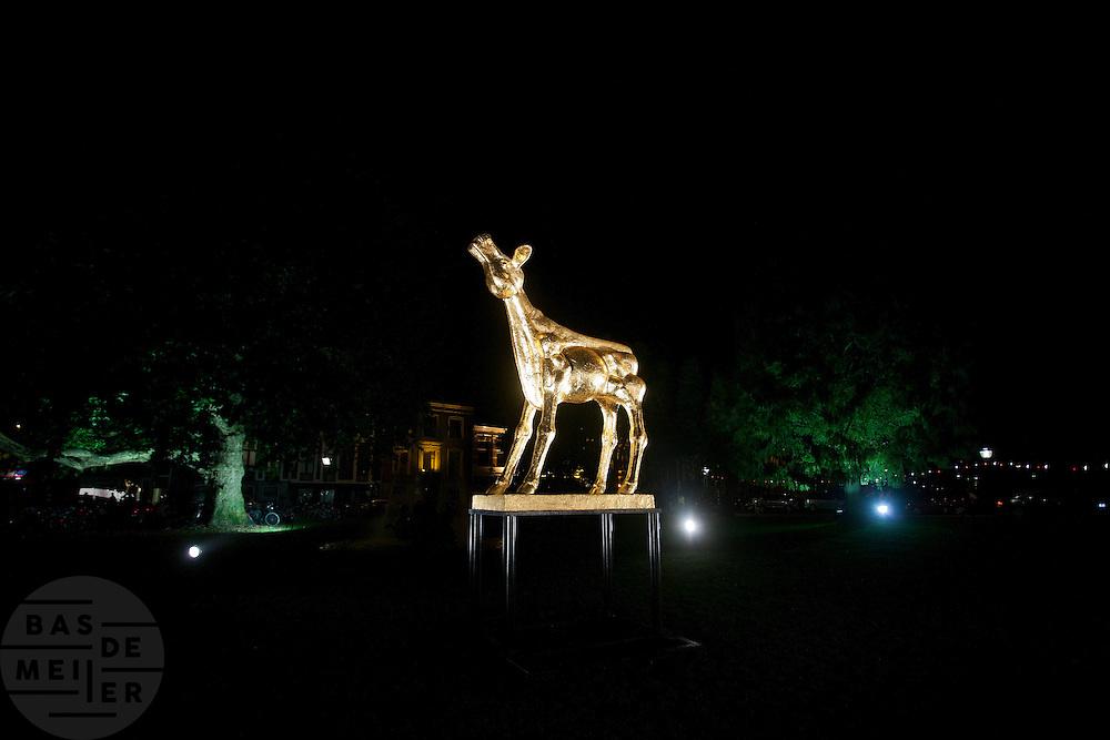 Het Gouden Kalf voor de Stadsschouwburg in Utrecht.<br /> <br /> The Gouden Kalf (Golden Calf) in front of  the Stadsschouwburg.