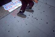 Homeless man age 41 sleeping on sidewalk.  New York New York USA