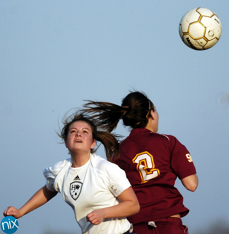 Hickory Ridge's Cecileigh Wirth fights Sun Valley's Katie Sinopoli for the ball Wednesday evening in Harrisburg.