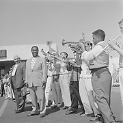 Y-570828B-12. Louis Armstrong at airport. With Phyllis Lauritz (reporter) August 28, 1957.570828B-12. Louis Armstrong at airport. With Phyllis Lauritz (reporter) August 28, 1957.