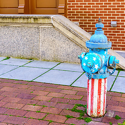 Harrisburg, PA / USA - May 15, 2020: A patriotic painted fire hydrant along a street in the downtown part of the city.