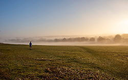© Licensed to London News Pictures. 30/12/2019. London, UK. A runner enjoys a wonderful misty morning in Richmond Park, London as forecasters predict unseasonably warm weather and possibly the the warmest New Year's Eve for over a 170 years. Photo credit: Alex Lentati/LNP