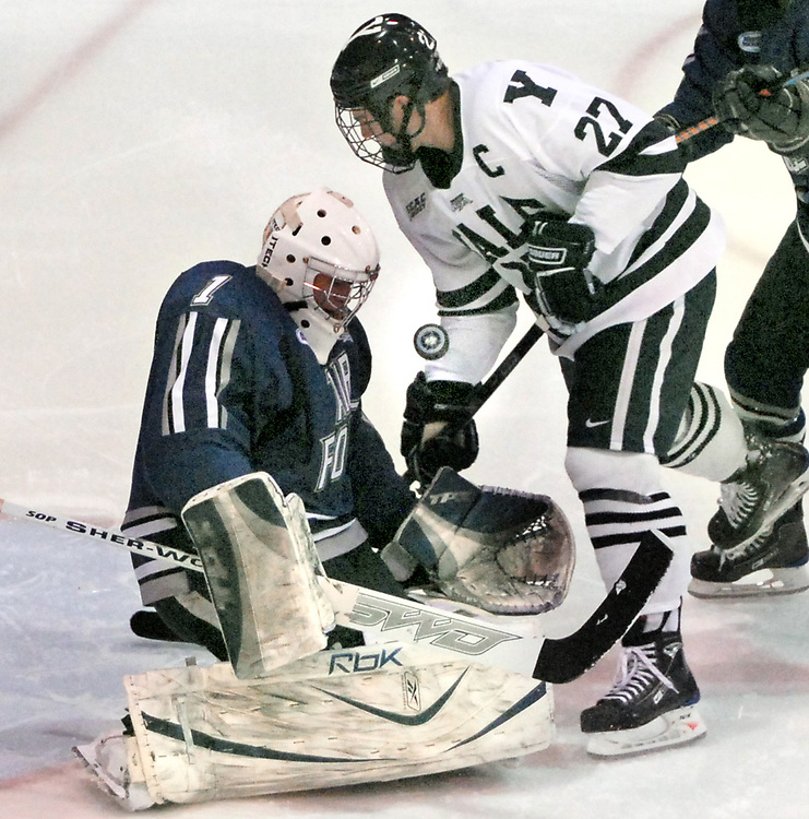 NE1/4/09 1 Yale Hockey<br /> ML0508C<br /> Ingalls Rink, Yale University, second period:  Air Force's goalie Andrew Volkening left successfully defends against Yale's Matt Nelson. Photo by Mara Lavitt