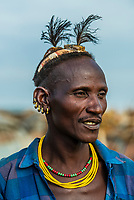 Head piece signifies this Dassanach tribe man as a village elder, Omo Valley, Ethiopia.