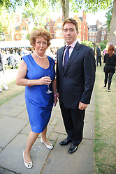 SUSIE BURROWS and her son CAPT.MATTHEW BURROWS at the Lord's Taverners Diamond Jubilee Garden Party held in College Gardens, Westminster Abbey, London on 8th July 2010.
