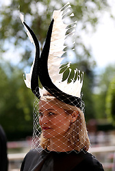 A racegoer during day five of Royal Ascot at Ascot Racecourse.