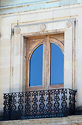 French doors reflecting deep blue sky on the Palacio de Gobierno, Oaxaca, Mexico.