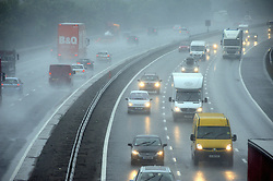 © Licensed to London News Pictures. 13/08/2015<br /> Wet driving conditions on the M25 near junction 3 for Swanley in Kent as thunderstorms hit the southeast. <br /> Wet weather TODAY (13.08.2015)<br /> A severe weather warning for rain and thunderstorms in London and south east England has been issued by the Met Office.  <br /> <br /> <br /> (Byline:Grant Falvey/LNP)