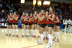 20 November 2004....Redbird team sings the fight song at the conclusion of a 4 game match win against the bulldogs, concluding the home games for the 2004 season.....Illinois State University Redbirds V Drake Bulldogs Women's Volleyball.  Redbird Arena, Illinois State University, Normal IL
