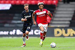 Lloyd Kelly of Bristol City is challenged by Lewis Wing of Middlesbrough - Rogan/JMP - 18/08/2018 - Ashton Gate Stadium - Bristol, England - Bristol City v Middlesbrough - Sky Bet Championship.