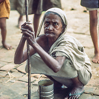 A homeless village woman from Bangladesh line up for a ration of milk and survival biscuits at  Mirpur Destitute Camp near Dhaka, 1977.  She had been had left destitute, widowed and violated  by  back-to -back cyclone and brutal 1971 war of independence