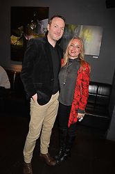 Iain Crawford and Erica Bergsmeds at an exhibition of photographs by Erica Bergsmeds held at The Den, 100 Wardour Street, London England. 19 January 2017.