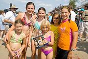 Winners and friends celebrating their victory as sand sculpture champions. Aquatennial Beach Bash Minneapolis Minnesota USA