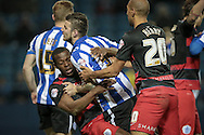 Nedum Onuoha (C) (QPR) is fouled by Daniel Pudil (Sheffield Wednesday) in the penalty box while they are jostling as the corner is delivered during the Sky Bet Championship match between Sheffield Wednesday and Queens Park Rangers at Hillsborough, Sheffield, England on 23 February 2016. Photo by Mark P Doherty.