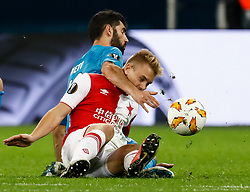 October 4, 2018 - Saint Petersburg, Russia - Luis Neto of FC Zenit Saint Petersburg and Jan Matousek (in front) of SK Slavia Prague vie for the ball during the Group C match of the UEFA Europa League between FC Zenit Saint Petersburg and SK Sparta Prague at Saint Petersburg Stadium on October 4, 2018 in Saint Petersburg, Russia. (Credit Image: © Mike Kireev/NurPhoto/ZUMA Press)