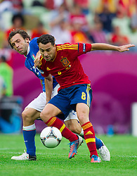 10-06-2012 VOETBAL: UEFA EURO 2012 DAY 3: POLEN OEKRAINE<br /> Andrea Pirlo of Italy vs Xavi Hernandez of Spain during the UEFA EURO 2012 group C match between Spain and Italy at The Arena Gdansk<br /> ***NETHERLANDS ONLY***<br /> ©2012-FotoHoogendoorn.nl