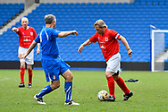 Spencer Pratten (Captain) of England over 60's takes on Franco Balocco of Italy during the world's first Walking Football International match between England and Italy at the American Express Community Stadium, Brighton and Hove, England on 13 May 2018. Picture by Graham Hunt.