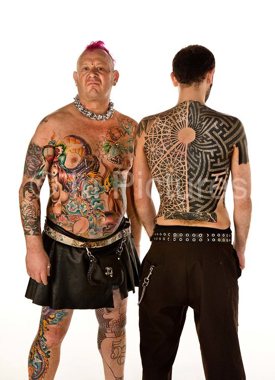Mad Alan with friend showing their tatoos