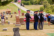 29 AUGUST 2020 - RUNNELLS, IOWA: Members of the Iowa Army National Guard Honor Guard with the casket of Pvt. Roy Brown Jr. in Runnells, IA. Pvt. Brown was a US Army soldier in World War II. He was an infantryman in the 126th Infantry Regiment, 32nd Infantry Division, serving in the Australian Territory of Papua (now Papua New Guinea). He went missing in action on Dec. 2, 1942. Unidentified remains were recovered on Feb. 2, 1943 and were eventually interred in the Manila American Cemetery. On May 14, 2019, Defense POW/MIA Accounting Agency using dental records, circumstantial evidence and DNA identified the remains as Pvt. Brown's. He was reinterred in the Lowman Cemetery in Runnells Saturday.    PHOTO BY JACK KURTZ