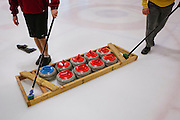 Curling stones are dragged across the ice during the San Francisco Bay Area Curling Club's Tuesday night league play at Sharks Ice in San Jose on Jan.15, 2013.