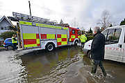 © Licensed to London News Pictures. 09/02/2014. Wraysbury, UK. The fire brigade work in the water. Flooding in Wraysbury in Berkshire today 9th February 2014 after the River Thames burst its banks. Photo credit : Stephen Simpson/LNP