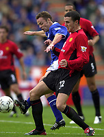 Photo: Richard Lane.<br />Leicester City v Manchester United. Barclaycard Premiership. 27/09/2003.<br />John O'Shea is challenged by Paul Dickov.