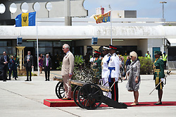 The Prince of Wales taking the final salute at Grantley Adams International Airport, Barbados, before he and the Duchess of Cornwall leave for Cuba.