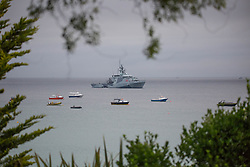 © Licensed to London News Pictures. 11/06/2021. St Ives, UK. River-class offshore patrol vessel of the Royal Navy is seen near Carbis Bay in Cornwall as the G7 summit starting today. About 6,500 police officers secure a meeting of world leaders with over 5,000 from all over the country. Estimated cost of policing is £70m. Photo credit: Marcin Nowak/LNP