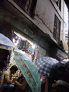 Shopping in the rain. Nepal's rainy season 2001 has bveen wetter than for may years. Umbrellas are the favourite protection against both sun and rain, here women are stopping and browsing jewelry in one of Kathmandu's narrow streets.