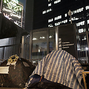 """The Umbrella Movement and tent camps were cleared off the streets shortly before Christmas by police but a small number of tents have been allowed to remain outside the Govenment offices. <br /> <br /> Hong Kong (香港; """"Fragrant Harbour""""), officially known as Hong Kong Special Administrative Region of the People's Republic of China since the hand-over from the United Kingdom in 1997 under the principle of """"one country, two systsems"""".  7 million people live on 1,104km square, making it the most vertivcal city in the world. Hong Kong is one of the world's leading financial centres along side London and New York, it has one of the highest income per capita in the world as well the moste severe income inequality amongst advanced economies. The Hong Kong civil society is highly regulated but has at the same time one of the most lassiez-faire economies with low taxation and free trade. Civil unrest and political dissent is unusual but in 2014 the Umbrella Movenment took to the streets of Hong Kong demanding democracy and universal suffrage. 93 % are ethnic Chinese, mostly Cantonese speaking."""