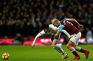 Pablo Zabaleta of West Ham United (R) battles with Son Heung-min of Tottenham Hotspur (L). Premier league match, Tottenham Hotspur v West Ham United at Wembley Stadium in London on Thursday  4th January 2018.<br /> pic by Steffan Bowen, Andrew Orchard sports photography.