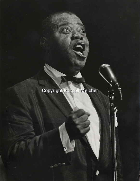 Louis Armstrong singing in the Olympia <br /> concert hall in Paris, in the mid fifties.<br /> <br /> Louis Armstrong chantant a l' Olympia<br /> de Paris, au milieu des années cinquante .