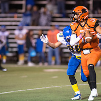 Junior quarterback for Gallup Jacob Ramirez looks downfield for a reciever as Bloomfield Bobcat Ethan Beevers closes in, Friday Oct. 19, 2018 in Gallup.