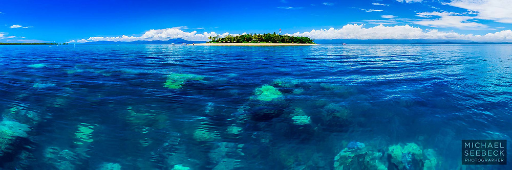 A panoramic photograph of the fringing reef at Low Isles with Low Isles in the distance, looking back towards the mainland.<br /> <br /> Code: HAQI0027<br /> <br /> Limited Edition of 125