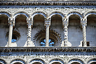Close up of the Arcades of St Michele of the 13th century Romanesque facade of the San Michele in Foro,  a Roman Catholic basilica church in Lucca, Tunscany, Italy .<br /> <br /> Visit our ITALY PHOTO COLLECTION for more   photos of Italy to download or buy as prints https://funkystock.photoshelter.com/gallery-collection/2b-Pictures-Images-of-Italy-Photos-of-Italian-Historic-Landmark-Sites/C0000qxA2zGFjd_k<br /> <br /> If you prefer to buy from our ALAMY PHOTO LIBRARY  Collection visit : https://www.alamy.com/portfolio/paul-williams-funkystock/lucca.html .<br /> <br /> Visit our MEDIEVAL PHOTO COLLECTIONS for more   photos  to download or buy as prints https://funkystock.photoshelter.com/gallery-collection/Medieval-Middle-Ages-Historic-Places-Arcaeological-Sites-Pictures-Images-of/C0000B5ZA54_WD0s
