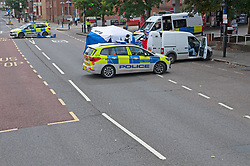 ©Licensed to London News Pictures 21/08/2020             Plumstead, UK. A forensic tent and a police cordon is in place. Parts of Plumstead high street in South East London are closed this morning after a man was fatally stabbed to death. It is believed the man was stabbed on Heron Hill a short distance away then transferred to Plumstead for the air ambulance. Photo credit: Grant Falvey/LNP
