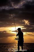 fisherman shore-casting<br /> Barking Sands Beach<br /> Kauai, Hawaii, USA ( Pacific )